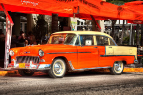 This Chevy Bel Air was parked outside the Ocean's Ten restaurant on Ocean Drive, South Beach Miami. Given the color coordination between the car and restaurant I'm guessing the car belongs to the restaurant owner.