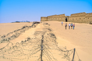 Tagrifet is an Italian Fort in Libya. Here a group of my colleagues approach the gate on the western wall of this triangular fort.