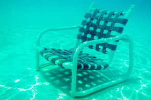 The Empty Chair sits at the bottom of a swimming pool.