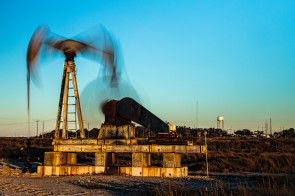 A long time exposure of a nodding donkey oil pump at High Island, Texas, shows the mechanics in motion.