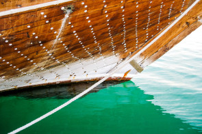 Bow of a traditional style dhow moored in the marina in Doha, Qatar.