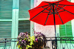 The red umbrella makes a statement in this balcony scene from St. Peter Street in the French Quarter. This abstract was a happy accident in Photoshop.